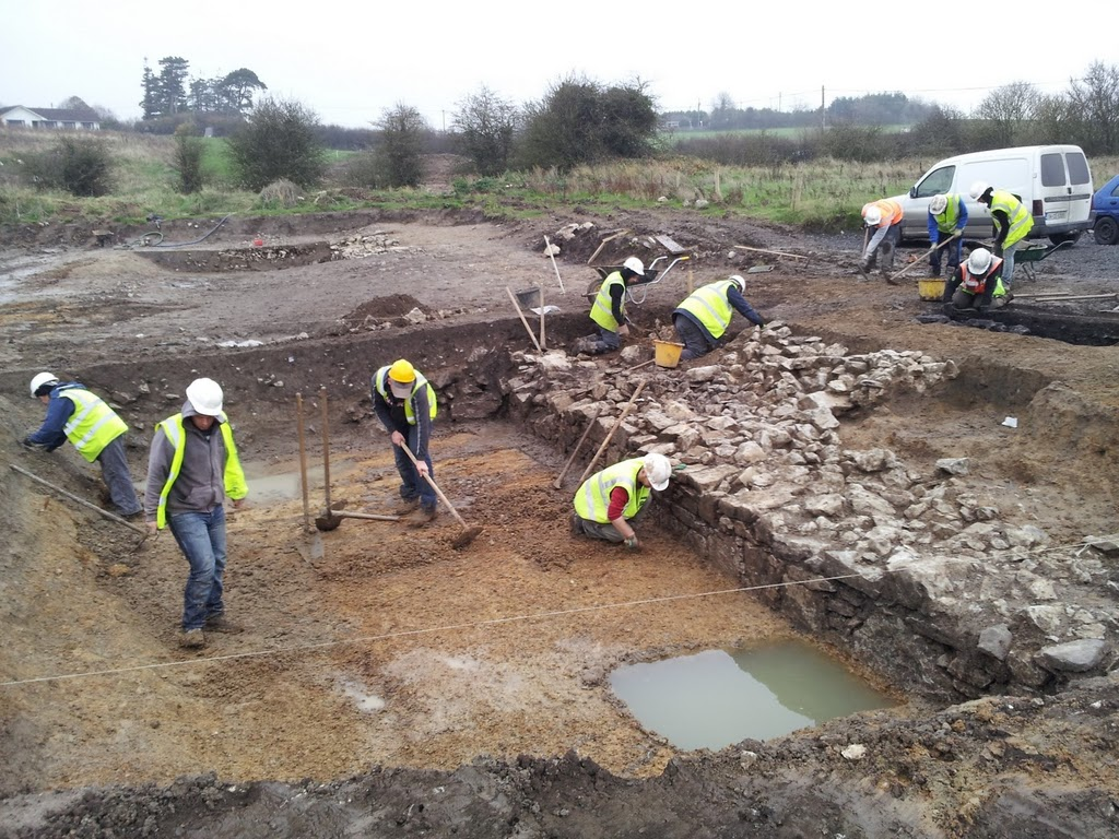 Excavation of the moat in progress, with the remains of the wall, or 'revetment' visible
