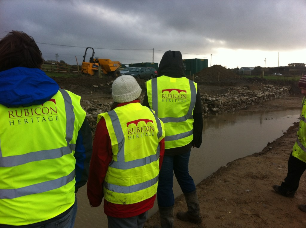 The team gaze nervously over the waterfilled moat and revetment...