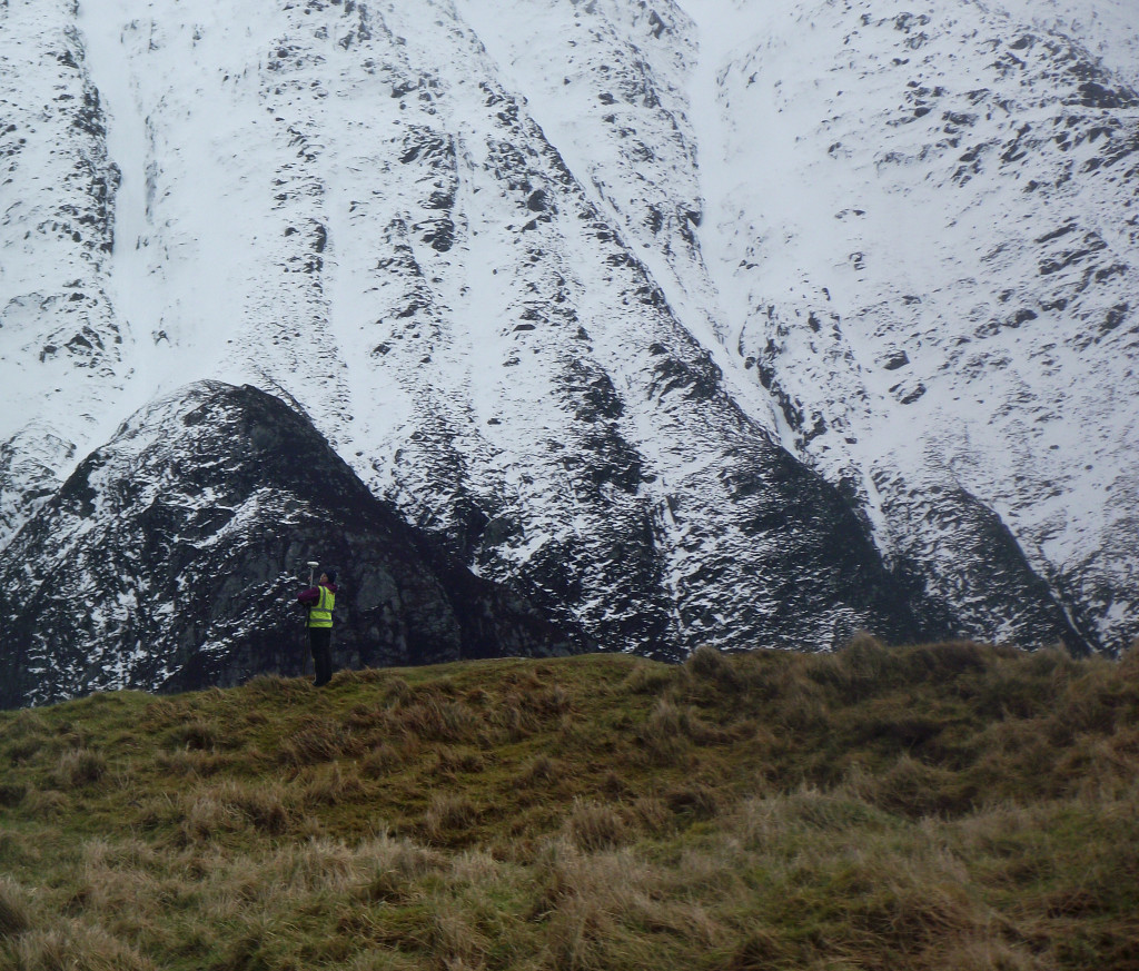 Another view of the vitrified hillfort survey in progress at Chraig Phadraig, with Ben Nevis in the background