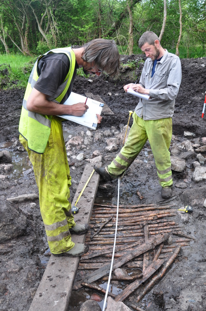 Rubicon's Hubert Ficner and Martin McGowan planning prehistoric worked timbers at Drumard 2, Co. Mayo (James Hession)