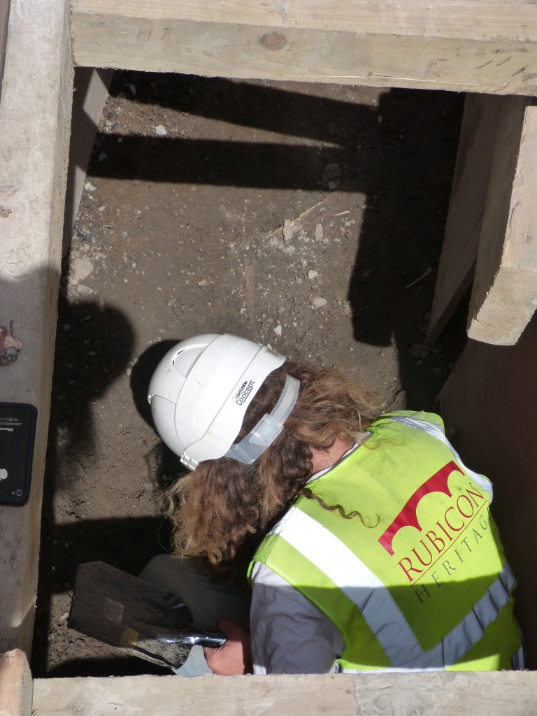 Rubicon's Ivan Pawle excavating human remains, discovered as part of the LUAS works outside Trinity College Dublin (Rubicon Heritage)
