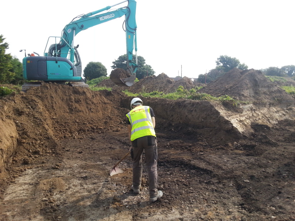 Rubicon's George Morgan works to find the extent of a burnt mound
