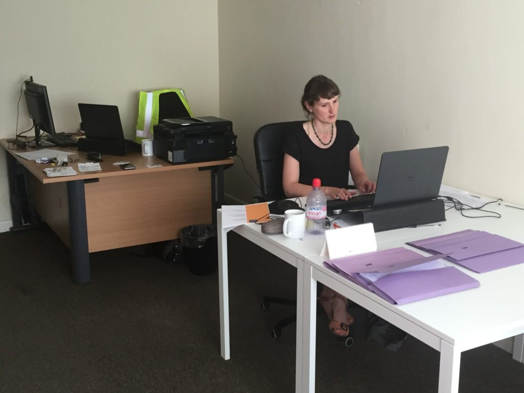 Rachel working away at her desk in the new place.